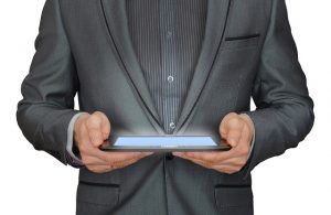 hypnotherapist with iPad for reading hypnotherapy scripts using autocue software
